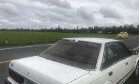Cần bán gấp Nissan Bluebird sản xuất 1986, màu trắng giá 50 triệu tại Kiên Giang