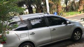 Cần bán xe Nissan Grand livina 1.8 MT đời 2011, màu bạc  giá 209 triệu tại Bình Dương